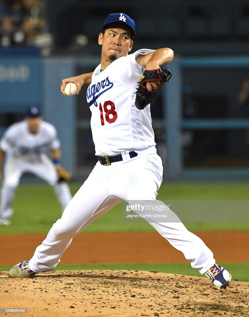 Kenta Maeda #18 of the Los Angeles Dodgers pitches in the fourth inning of the game against the Milwaukee Brewers at Dodger Stadium on July 30, 2018 in Los Angeles, California.