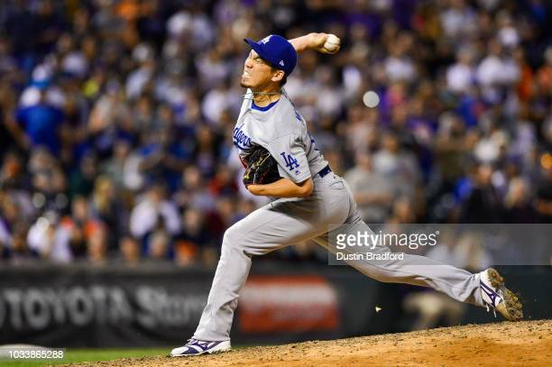 Kenta Maeda of the Los Angeles Dodgers pitches in the ninth inning with a runner on and one out against the Colorado Rockies at Coors Field on...