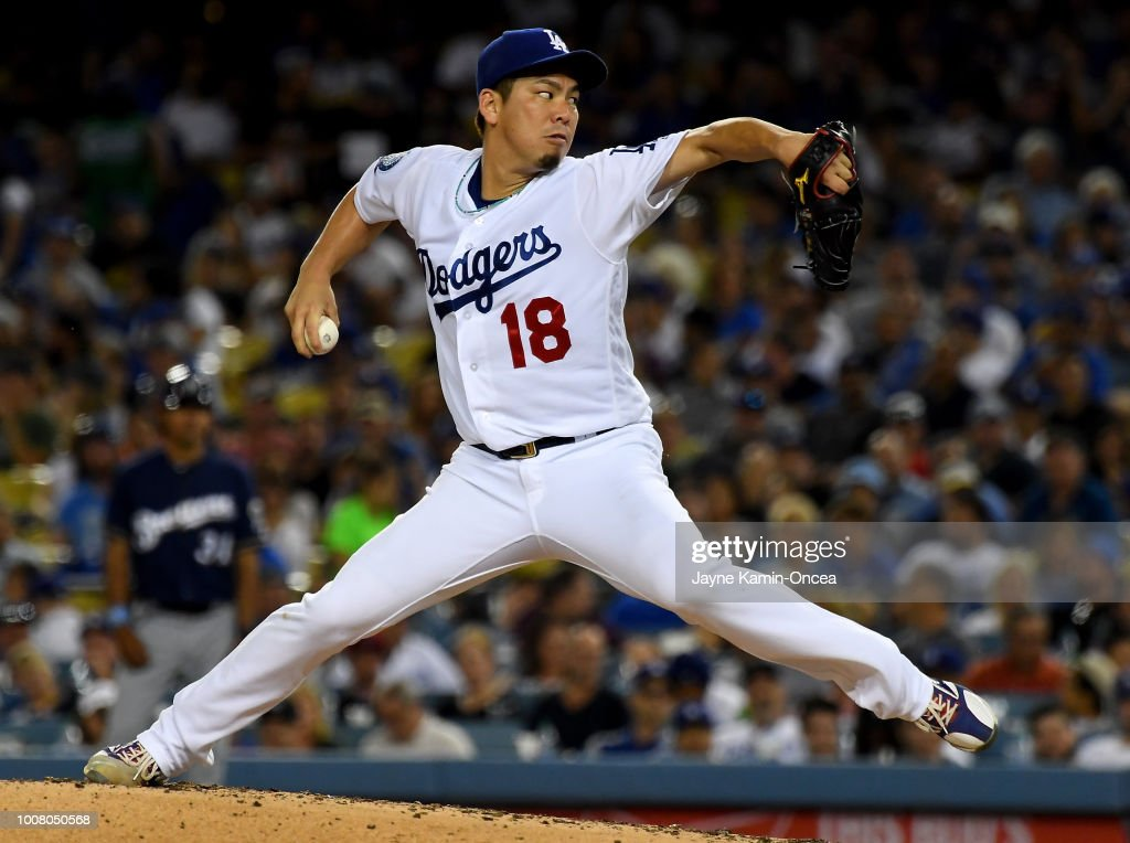 Kenta Maeda #18 of the Los Angeles Dodgers pitches in the second inning of the game against the Milwaukee Brewers at Dodger Stadium on July 30, 2018 in Los Angeles, California.