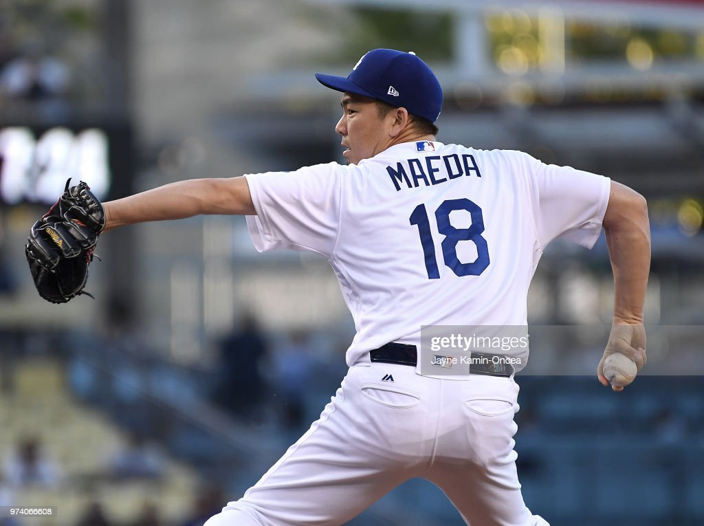 Kenta Maeda #18 of the Los Angeles Dodgers pitches in the second inning of the game against the Texas Rangers at Dodger Stadium on June 13, 2018 in Los Angeles, California.