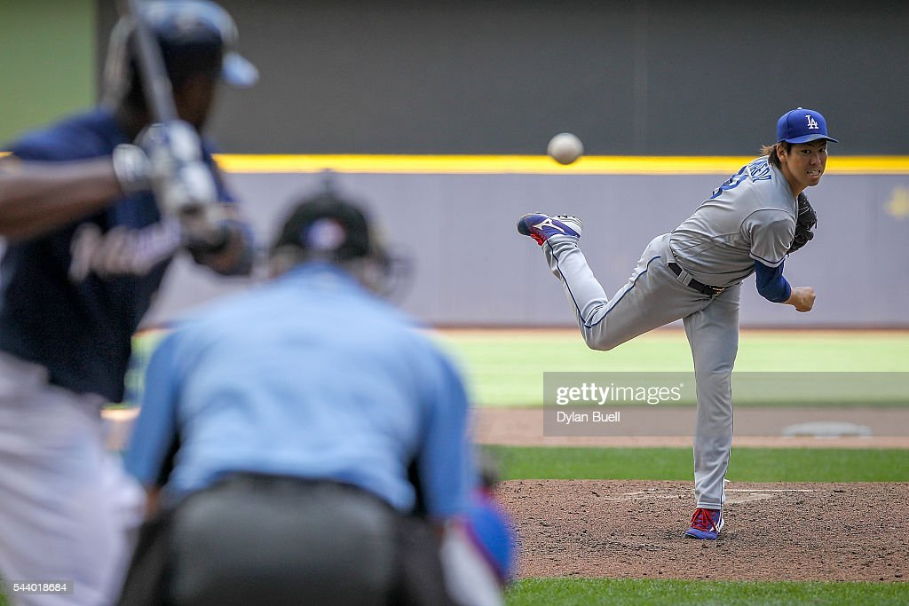 Kenta Maeda #18 of the Los Angeles Dodgers pitches in the sixth inning against the Milwaukee Brewers at Miller Park on June 30, 2016 in Milwaukee, Wisconsin.