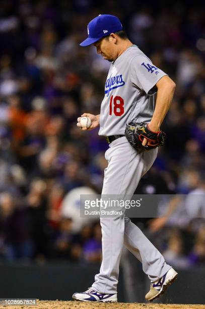 Kenta Maeda of the Los Angeles Dodgers prepares on the mound for a ninth inning appearance with a runner on and one out against the Colorado Rockies...