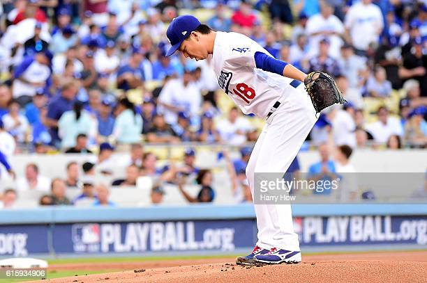 Kenta Maeda of the Los Angeles Dodgers prepares to pitch in the first inning against the Chicago Cubs in game five of the National League Division...