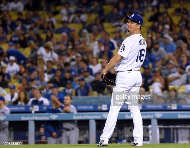 Kenta Maeda of the Los Angeles Dodgers reacts after a sacrifice bunt from Kevin Plawecki of the New York Mets during the ninth inning at Dodger...