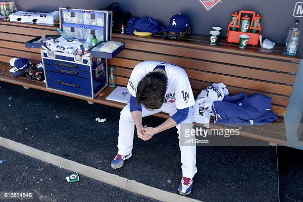 Kenta Maeda of the Los Angeles Dodgers reacts after being taken out of the game in the third inning against the Washington Nationals in game three of...