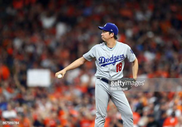 Kenta Maeda of the Los Angeles Dodgers reacts after giving up a threerun home run in the fifth inning of Game 5 of the 2017 World Series against the...