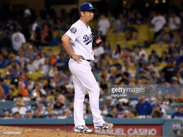Kenta Maeda of the Los Angeles Dodgers reacts after giving up a three run homerun to Brandon Nimmo of the New York Mets to trail 41 during the ninth...