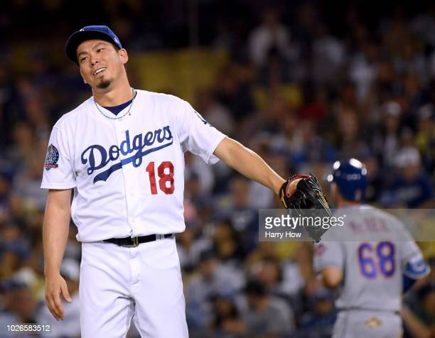 Kenta Maeda of the Los Angeles Dodgers reacts after hitting Jeff McNeil of the New York Mets during the ninth inning at Dodger Stadium on September 3...
