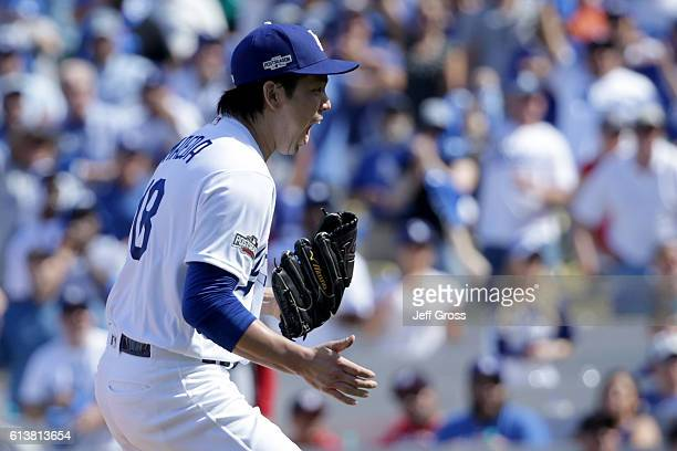 Kenta Maeda of the Los Angeles Dodgers reacts after striking out Ryan Zimmerman of the Washington Nationals in the first inning against of the...