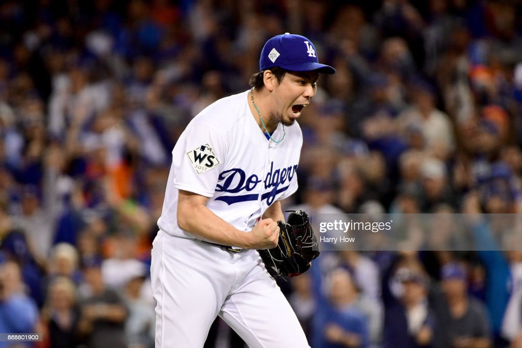 Kenta Maeda #18 of the Los Angeles Dodgers reacts after the final out in the seventh inning against the Houston Astros during game six of the 2017 World Series at Dodger Stadium on October 31, 2017 in Los Angeles, California.
