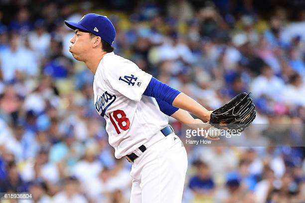 Kenta Maeda of the Los Angeles Dodgers reacts against the Chicago Cubs in game five of the National League Division Series at Dodger Stadium on...