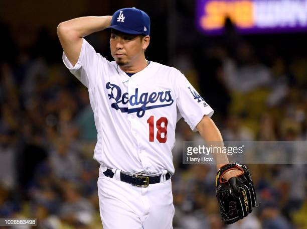 Kenta Maeda of the Los Angeles Dodgers reacts as he leaves the game after giving up a three run homerun to Brandon Nimmo of the New York Mets to...