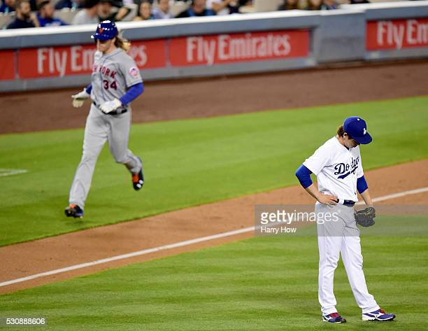 Kenta Maeda of the Los Angeles Dodgers reacts as Noah Syndergaard of the New York Mets runs home after his three run homerun and second homerun of...