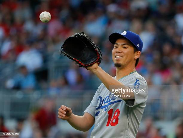 Kenta Maeda of the Los Angeles Dodgers reacts during the first inning against the Atlanta Braves at SunTrust Park on August 1 2017 in Atlanta Georgia
