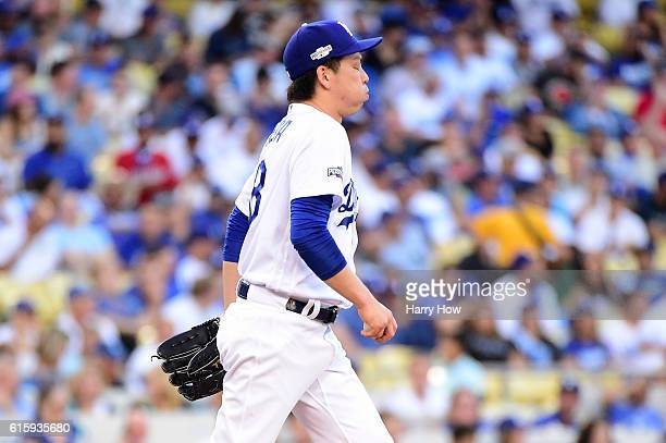 Kenta Maeda of the Los Angeles Dodgers reacts in the first inning against the Chicago Cubs in game five of the National League Division Series at...