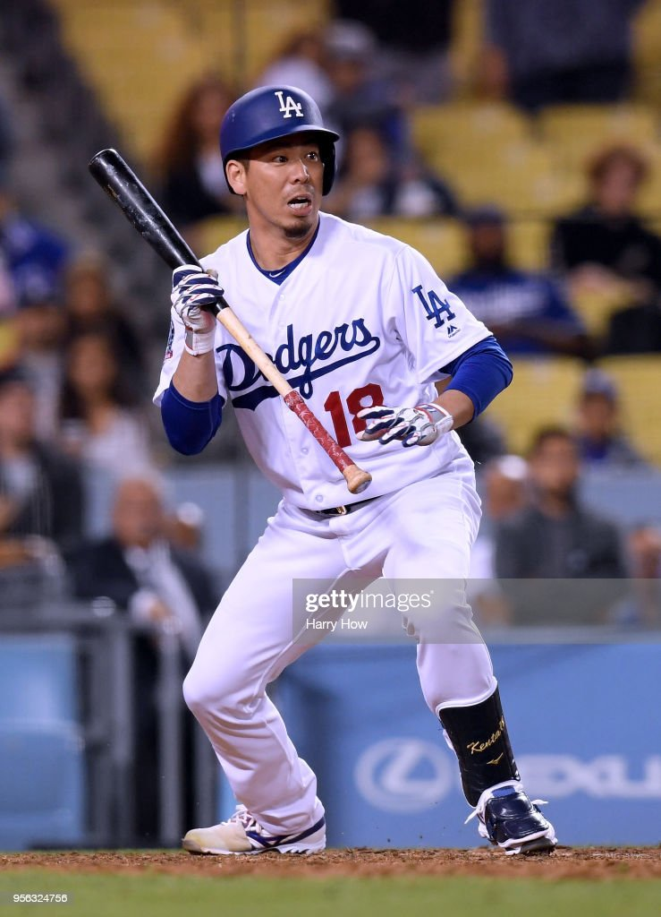 Kenta Maeda #18 of the Los Angeles Dodgers reacts to his bunt during the 12th inning against the Arizona Diamondbacks at Dodger Stadium on May 8, 2018 in Los Angeles, California.