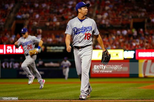 Kenta Maeda of the Los Angeles Dodgers returns to the dugout after recording the final out of the fifth inning against the St Louis Cardinals at...