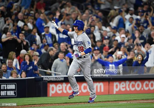 Kenta Maeda of the Los Angeles Dodgers rounds the bases after hitting a solo home run during the foufth inning of a baseball game against the San...