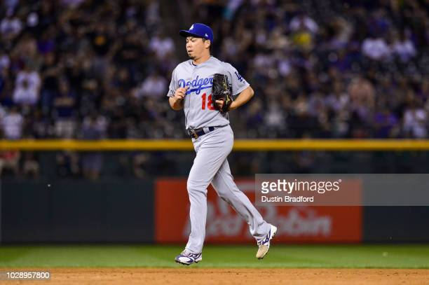 Kenta Maeda of the Los Angeles Dodgers runs onto the field for a ninth inning appearance with a runner on and one out against the Colorado Rockies at...