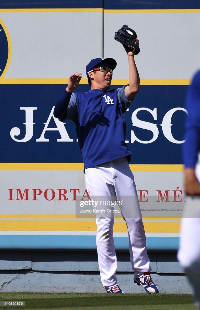 Kenta Maeda #18 of the Los Angeles Dodgers shags fly balls during batting practice before the game against the Arizona Diamondbacks at Dodger Stadium on April 14, 2018 in Los Angeles, California.