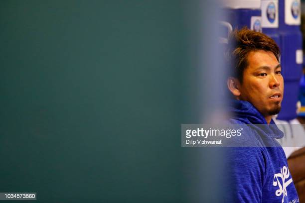 Kenta Maeda of the Los Angeles Dodgers sits in the dugout after recording the final out of the fifth inning against the St Louis Cardinals at Busch...