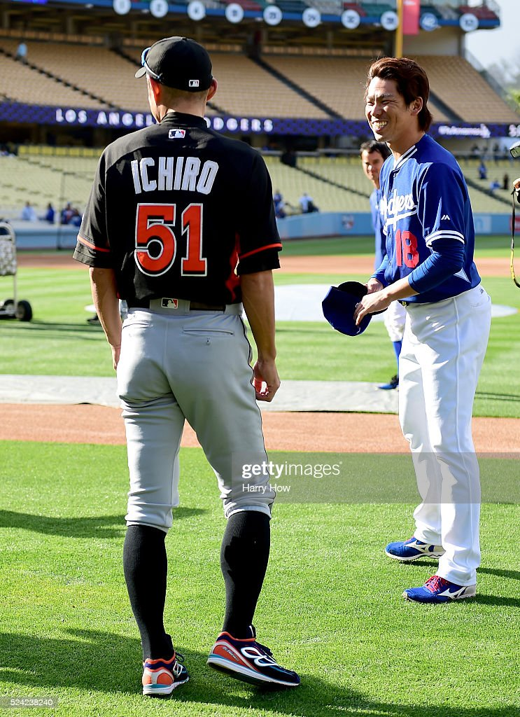 Kenta Maeda #18 of the Los Angeles Dodgers smiles with Ichiro Suzuki #51 of the Miami Marlins before the game at Dodger Stadium on April 25, 2016 in Los Angeles, California.