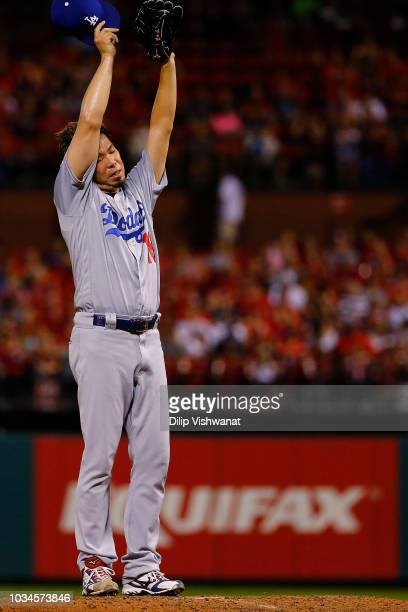 Kenta Maeda of the Los Angeles Dodgers stretches inbetween pitches against the St Louis Cardinals in the fifth inning at Busch Stadium on September...