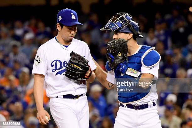 Kenta Maeda of the Los Angeles Dodgers talks with Austin Barnes during the seventh inning against the Houston Astros in game six of the 2017 World...