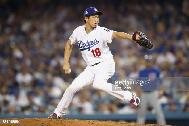 Kenta Maeda of the Los Angeles Dodgers throws a pitch against the Chicago Cubs in the sixth inning during Game One of the National League...
