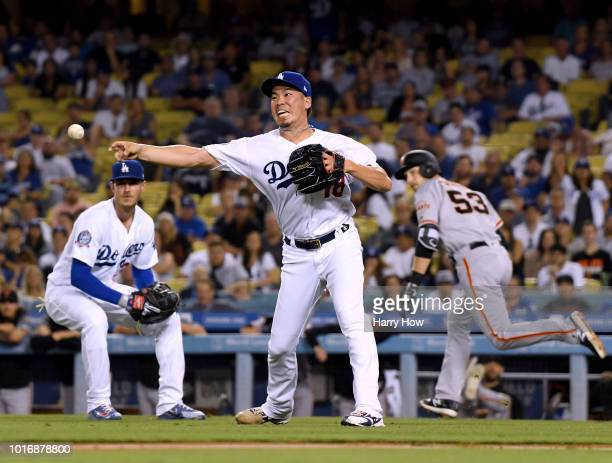 Kenta Maeda of the Los Angeles Dodgers pitches in relief during the ninth inning against the San Francisco Giants at Dodger Stadium on August 14 2018...