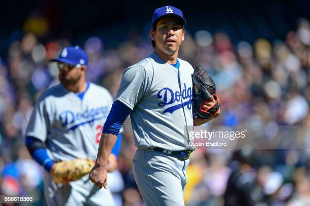 Kenta Maeda of the Los Angeles Dodgers walks off the field after the fifth inning of a game against the Colorado Rockies at Coors Field on April 9...
