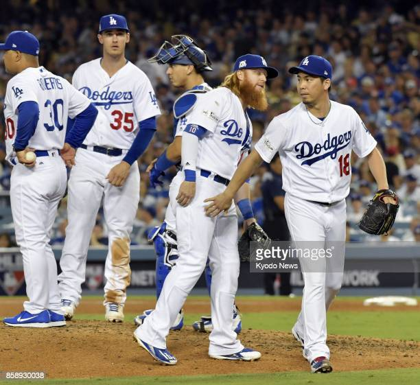 Kenta Maeda of the Los Angeles Dodgers walks off the mound in the sixth inning of a National League Division Series game against the Arizona...