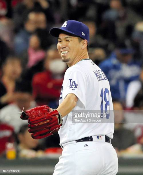 Kenta Maeda of the Los Angeles Dodgers walks to the dugout after the top of 2nd inning during the game four between Japan and MLB All Stars at Mazda...