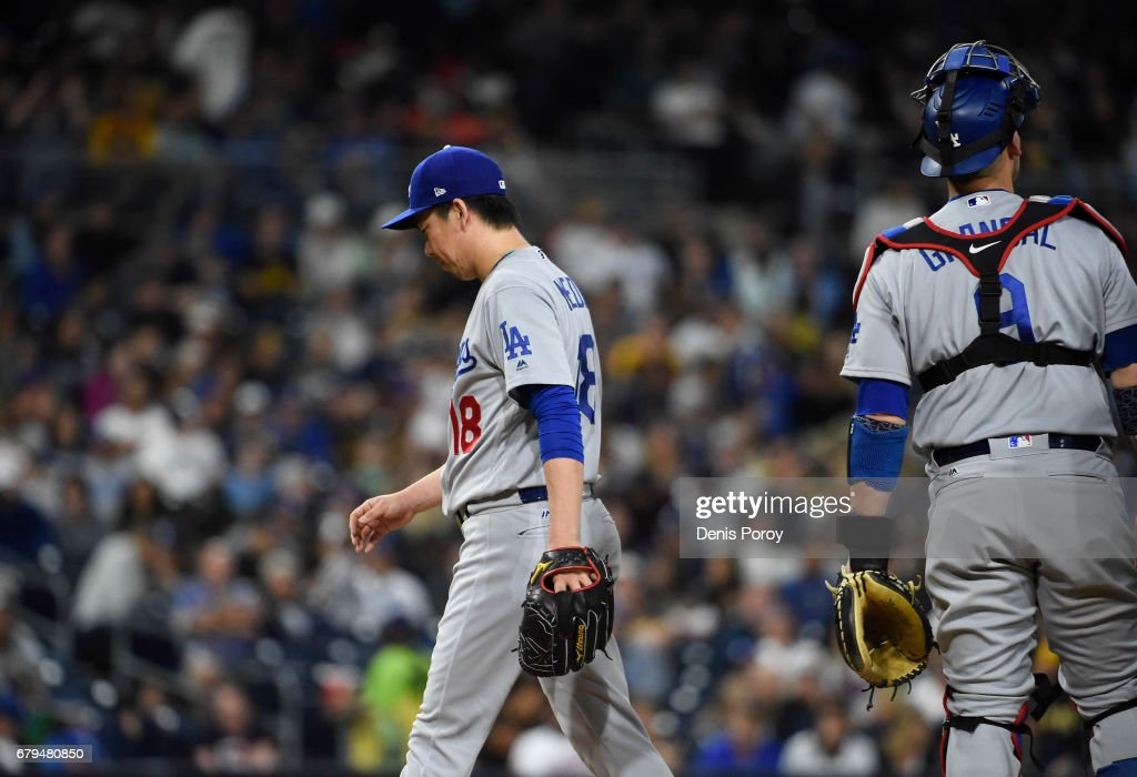 Kenta Maeda #18 of the Los Angeles Dodgers walks to the dugout as he leaves the game during the sixth inning of a baseball game against the San Diego Padres at PETCO Park on May 5, 2017 in San Diego, California.