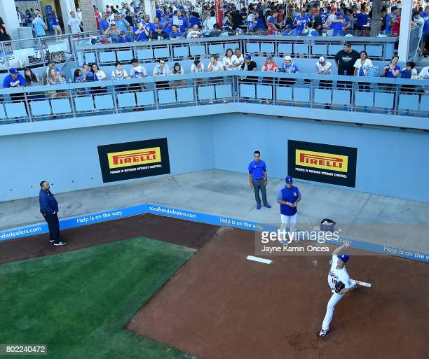 Kenta Maeda of the Los Angeles Dodgers warms up in the bullpen before the game against the Los Angeles Angels of Anaheim at Dodger Stadium on June 27...