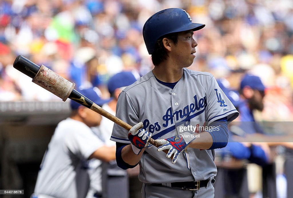 Kenta Maeda #18 of the Los Angeles Dodgers warms up in the on-deck circle in the sixth inning against the Milwaukee Brewers at Miller Park on June 30, 2016 in Milwaukee, Wisconsin.