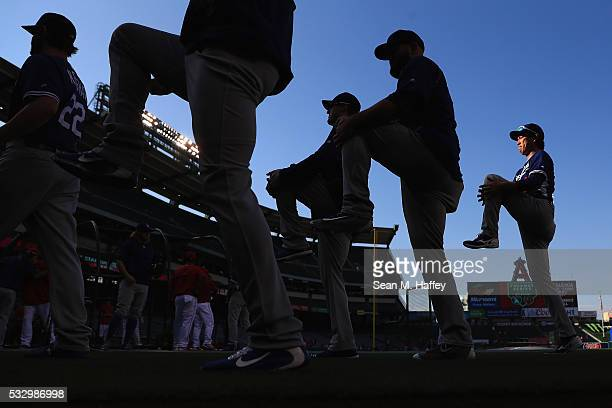 Kenta Maeda of the Los Angeles Dodgers warms up with teamates prior to a baseball game between the Los Angeles Angels of Anaheim and the Los Angeles...