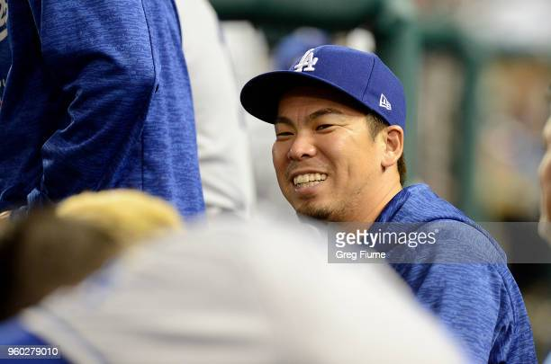 Kenta Maeda of the Los Angeles Dodgers watches the game in the eighth inning against the Washington Nationals at Nationals Park during game two of a...