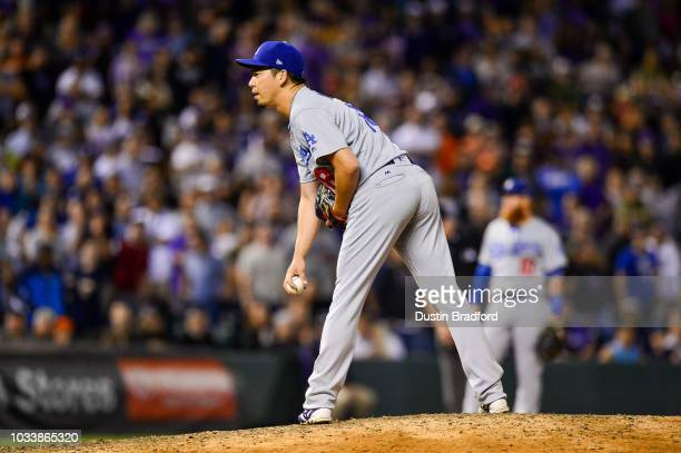 Kenta Maeda of the Los Angeles Dodgers works from the stretch in the ninth inning with a runner on and one out against the Colorado Rockies at Coors...