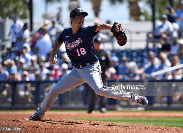 Kenta Maeda of the Minnesota Twins delivers a pitch in the first inning during the spring training game against the Tampa Bay Rays at Charlotte...