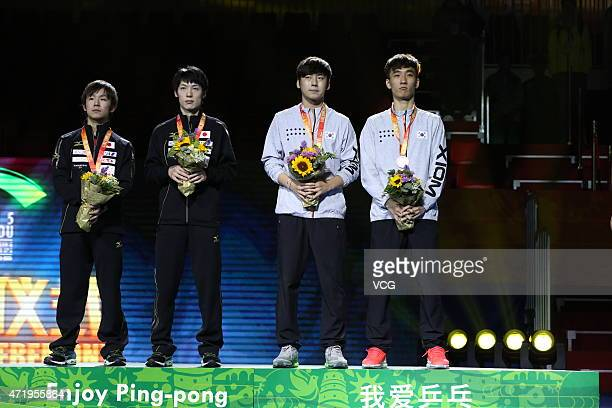 Kenta Matsudaira and Koki Niwa of Japan, Lee Sang-Su and Seo Hyun-deok of South Korea stand on the podium after men's mixed doubles final match on...