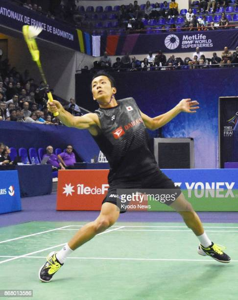 Kenta Nishimoto of Japan returns a shot during the men's singles final against Srikanth Kidambi of India at the French Open Superseries tournament at...