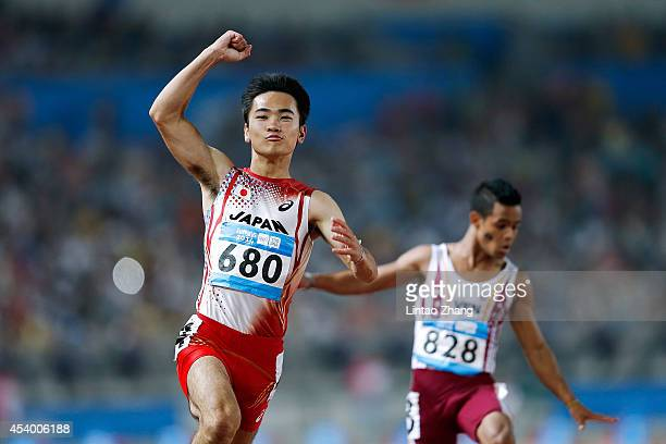 Kenta Oshima of Japan celebrates after the Men's 100m Final of Nanjing 2014 Summer Youth Olympic Games at the Nanjing Olympic Sports Centre on August...