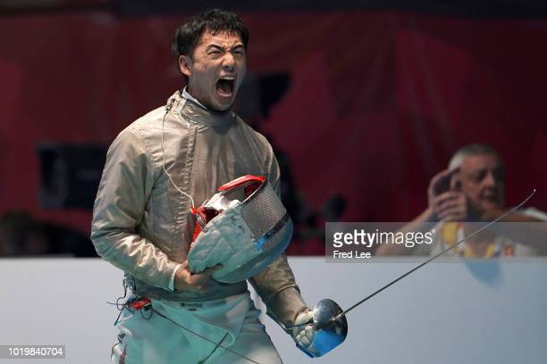 Kenta Tokunan of Japan celebrates during Men's Sabre Individual Round of 16 on day two of the Asian Games on August 20, 2018 in Jakarta, Indonesia.