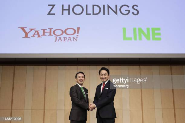Kentaro Kawabe, president and chief executive officer of Z Holdings Corp., formerly known as Yahoo Japan, left, and Takeshi Idezawa, chief executive...