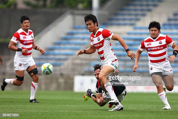 Kentaro Kodama of Japan runs with the ball during the Asia Rugby Championship match between Japan and Hong Kong at Prince Chichibu Stadium on May 27...