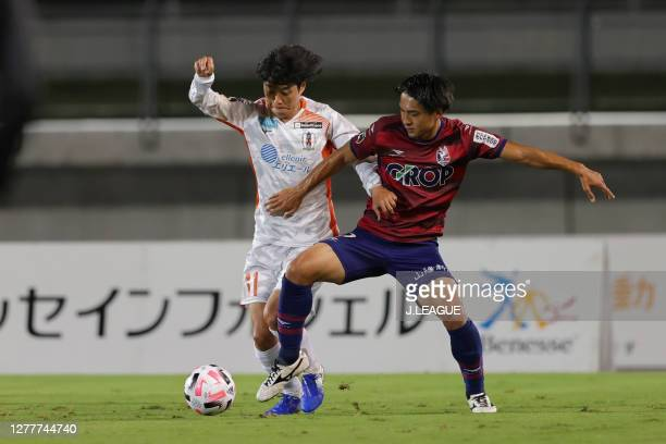 Kentaro MORIYA of Ehime FC and Eiji SHIRAI of Fagiano Okayama battle for the ball during the J.League Meiji Yasuda J2 match between Fagiano Okayama...