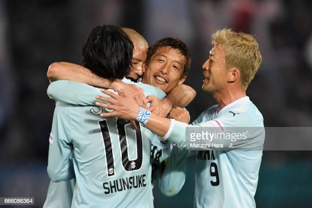 Kentaro Oi of Jubilo Iwata celebrates scoring his side's first goal with his team mates Shunsuke Nakamura Kengo Kawamata and Yoshiaki Ota of Jubilo...