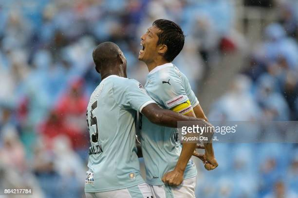 Kentaro Oi of Jubilo Iwata celebrates scoring his side's first goal with his team mate Adailton during the JLeague J1 match between Jubilo Iwata and...