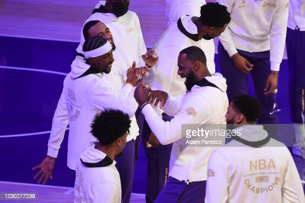 Kentavious Caldwell-Pope and LeBron James of the Los Angeles Lakers react as they get their 2019-20 NBA Championship ring during the ring ceremony...